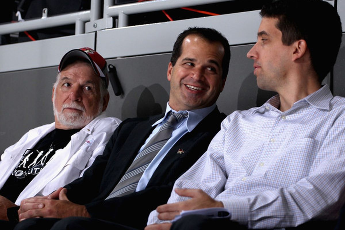 GLENDALE AZ :  Matthew Hulsizer (C) CEO of PEAK6 Investments attends the NHL game between the Detroit Red Wings and the Phoenix Coyotes at Jobing.com Arena on in Glendale Arizona.  (Photo by Christian Petersen/Getty Images)