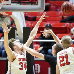 Utah Utes forward Jayce Johnson (34) gets slapped in the face by Hawaii Warriors center Ido Flaisher (15) as Utah hosts Hawaii at the Huntsman Center in Salt Lake on Saturday, Dec. 2, 2017.