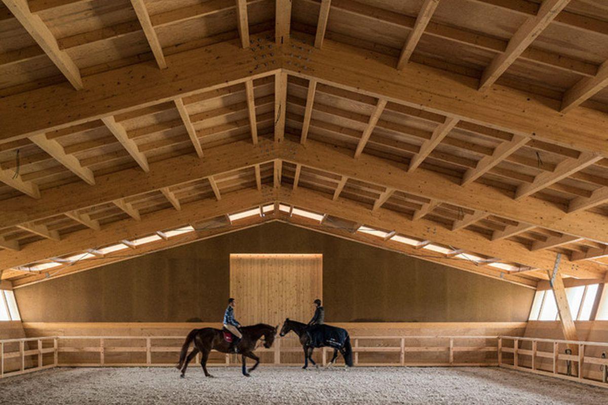 """All photos by <a href=""""http://ultimasreportagens.com/"""">Fernando Guerra</a> via <a href=""""http://www.dezeen.com/2015/06/17/castanheira-bastai-arquitectos-timber-framed-equestrian-centre-portugal-northern-coast-cabo-do-mundo-leca-da-palmeira/"""">Dezeen</"""