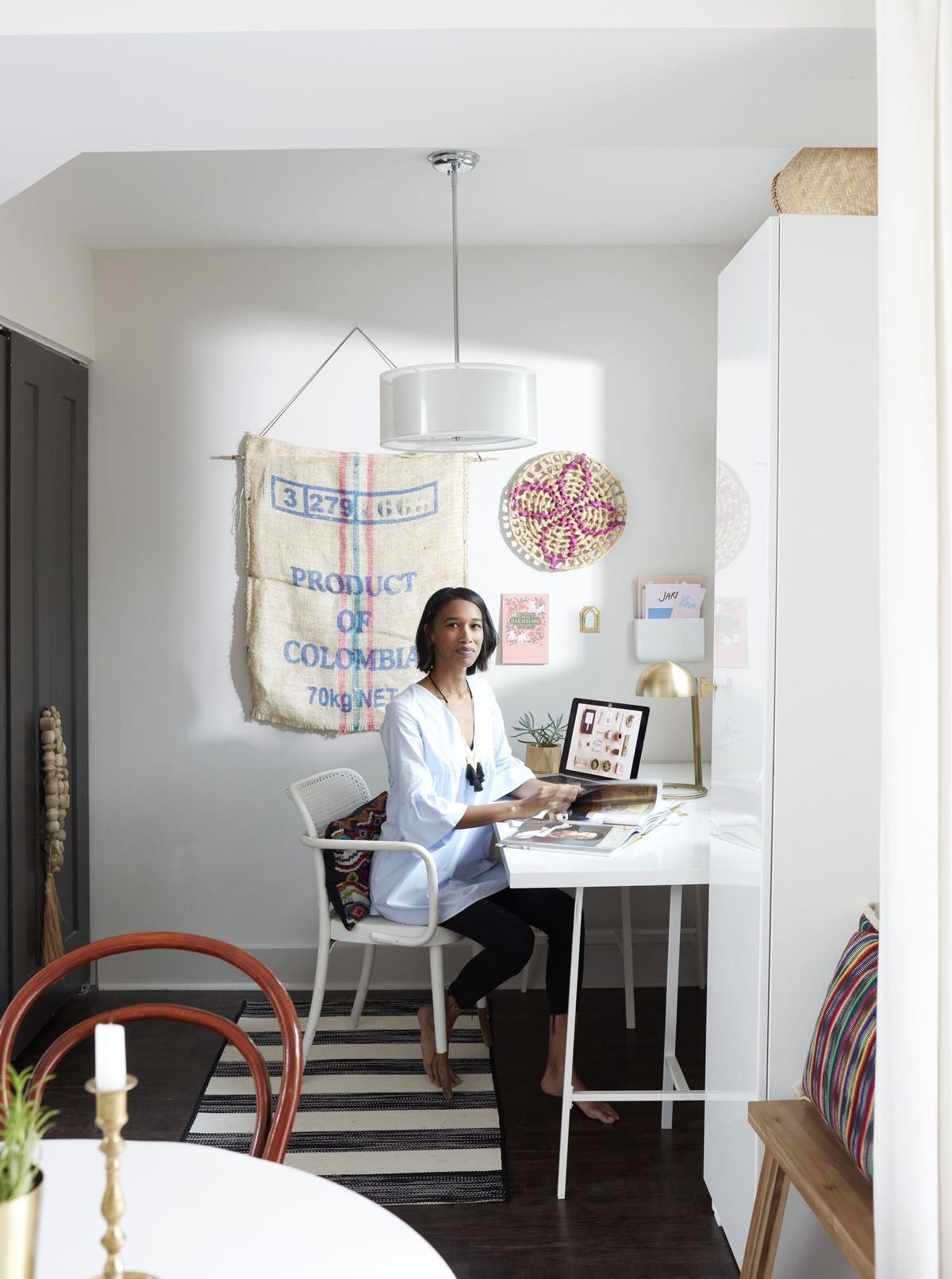 Giana Shorthouse sits in a small area off the kitchen; it was meant to be a breakfast room, she uses it as an office. It's set up with a white desk and chair.