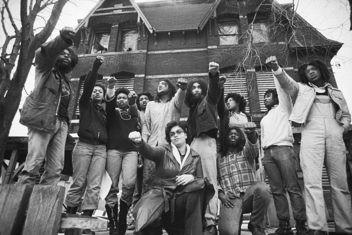 Members of MOVE gather in front of their house in the Powelton Village neighborhood of Philadelphia, Pennsylvania, in 1978.