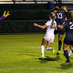 #13 Toriana Patterson flicks the ball past the UCF goalkeeper.