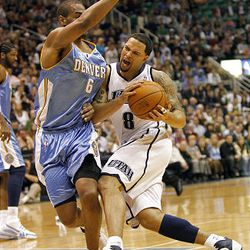 Utah's Deron Williams drives for a 3-point-play  on Denver's Arron Afflalo as the Utah Jazz and the Denver Nuggets play in game 3 of the first round of the NBA basketball playoffs Friday.