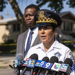 Glen Brooks, of the Chicago Police Department, looks on as Sgt. Cindy Guerra speaks to reporters after an officer shot an alleged suspect inside an apartment in the 6200 block of West Grand Avenue, Monday morning, July 8, 2019.