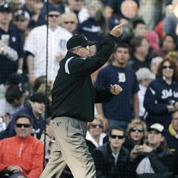Umpire Dale Scott signals home run for Detroit Tigers' Miguel Cabrera after an instant replay review in the fifth inning of a baseball game against the Boston Red Sox Saturday, April 7, 2012, in Detroit.