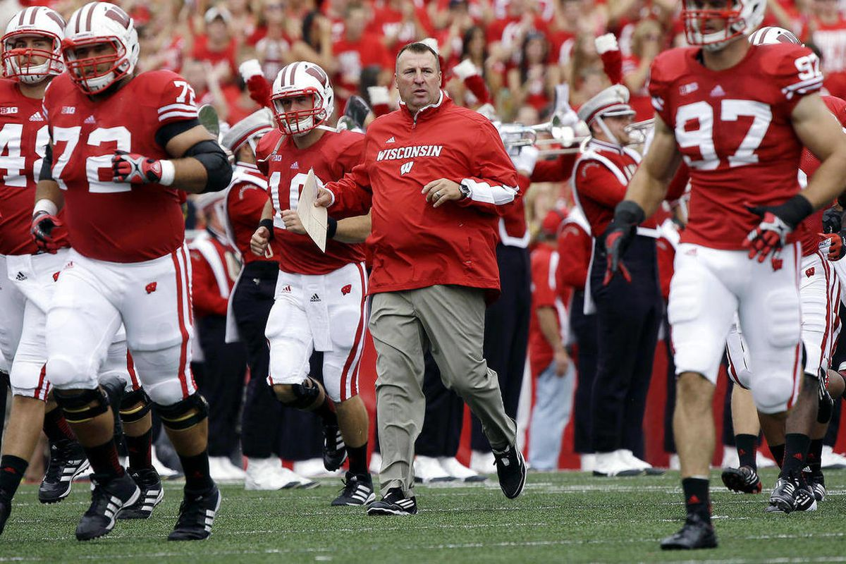 Wisconsin head coach Bret Bielema leads his team on the field before the first half of an NCAA college football game against Northern Iowa Saturday, Sept. 1, 2012, in Madison, Wis.
