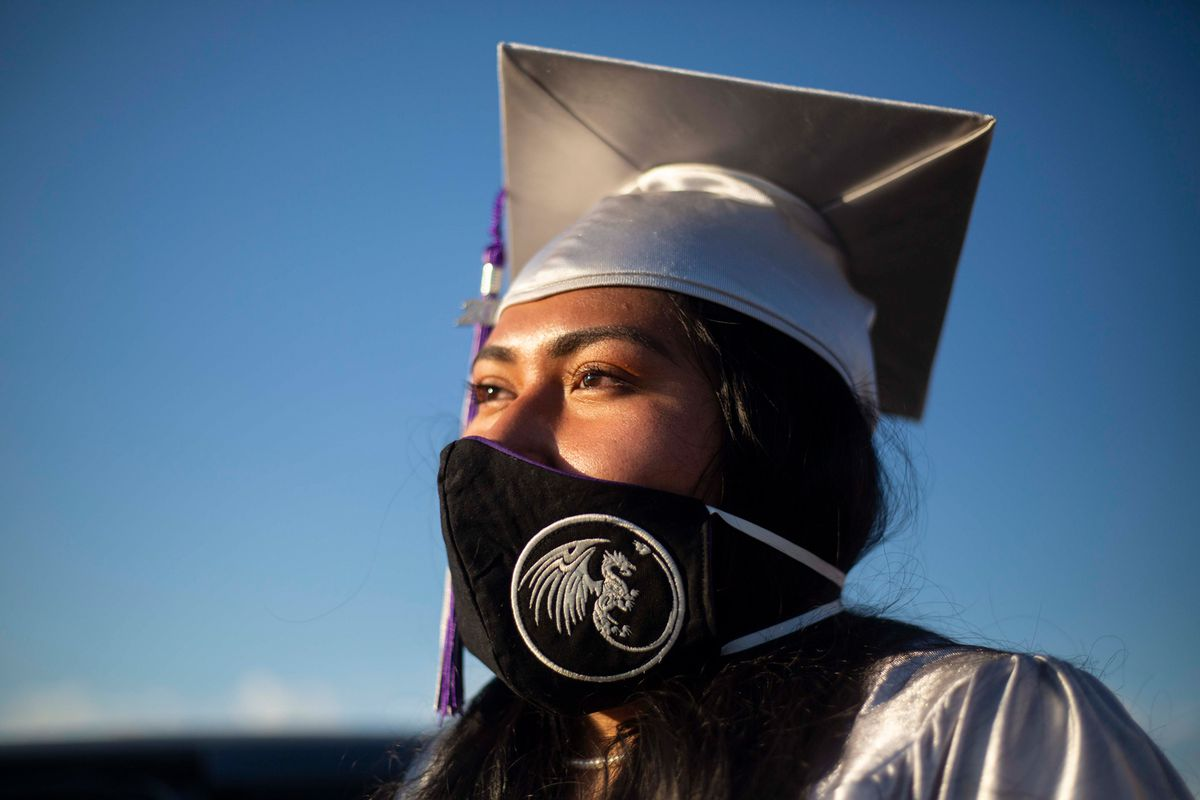 Marissa Moore in her cap, gown, and mask