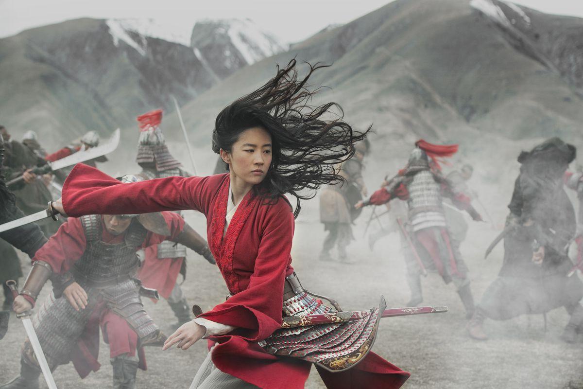 a woman wields a sword in battle
