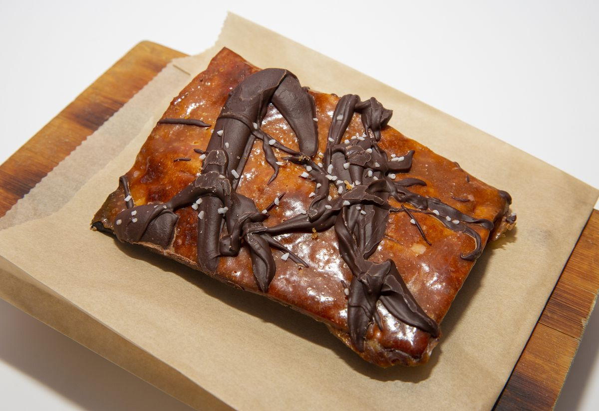 A golden brown piece of toffee-coated matzo with dollops of melted chocolate on top