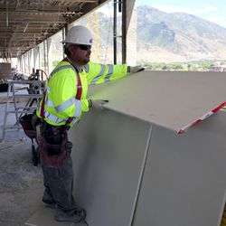 Juan Carlos Becerra, with SDI Drywall, cuts drywall for the new patient tower at Utah Valley Hospital in Provo on Tuesday, July 5, 2016.