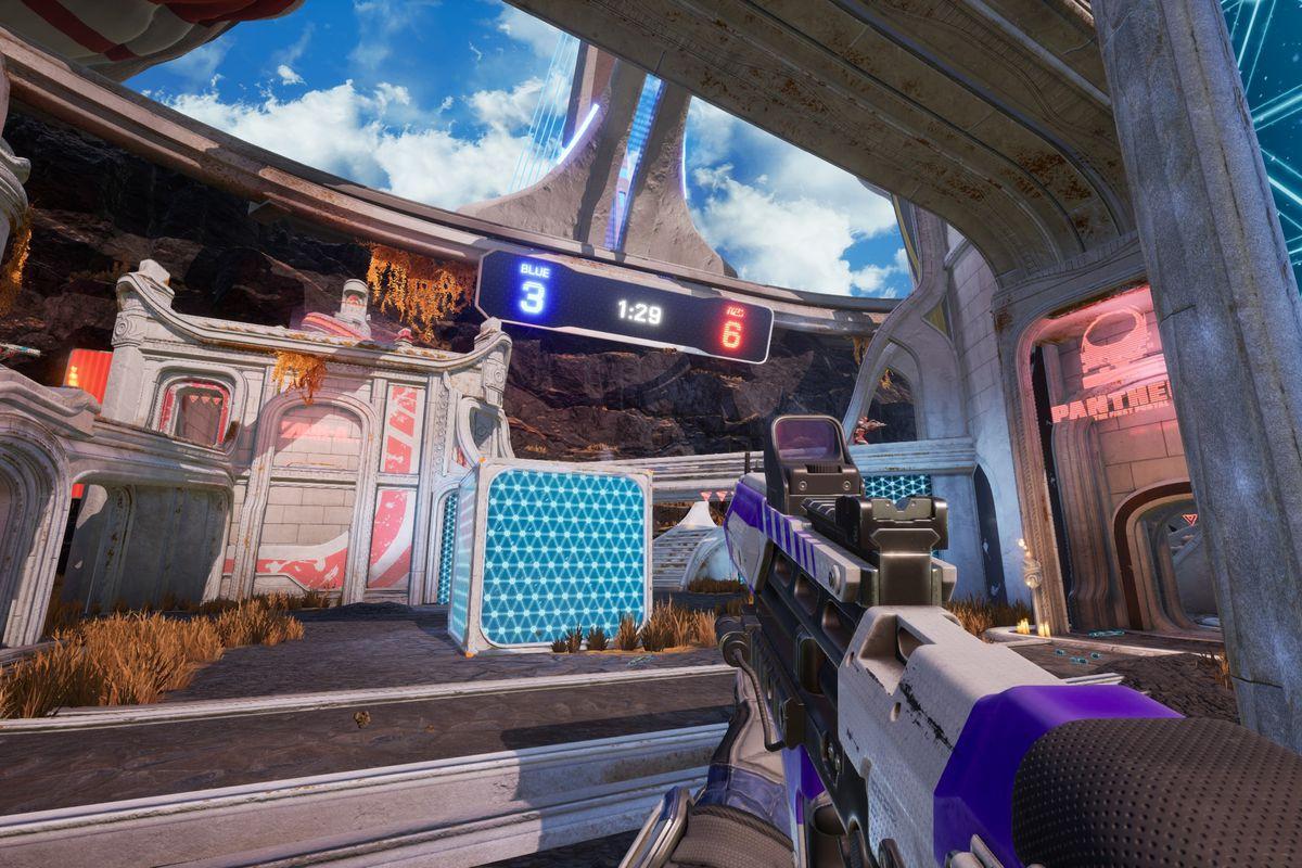 Splitgate- a player looks at a blue mesh portal wall