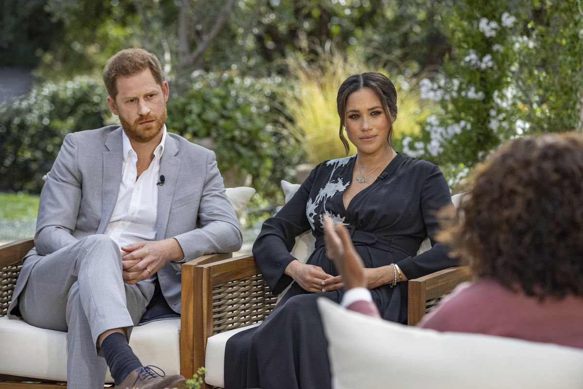 """This image provided by Harpo Productions shows Prince Harry, from left, and Meghan, Duchess of Sussex, in conversation with Oprah Winfrey. """"Oprah with Meghan and Harry: A CBS Primetime Special"""" airs March 7."""