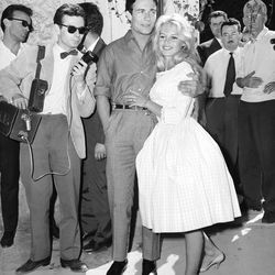 In a feminine gingham Vichy dress, Brigitte Bardot got remarried to Jacques Charrier on June 18th, 1959 in France.