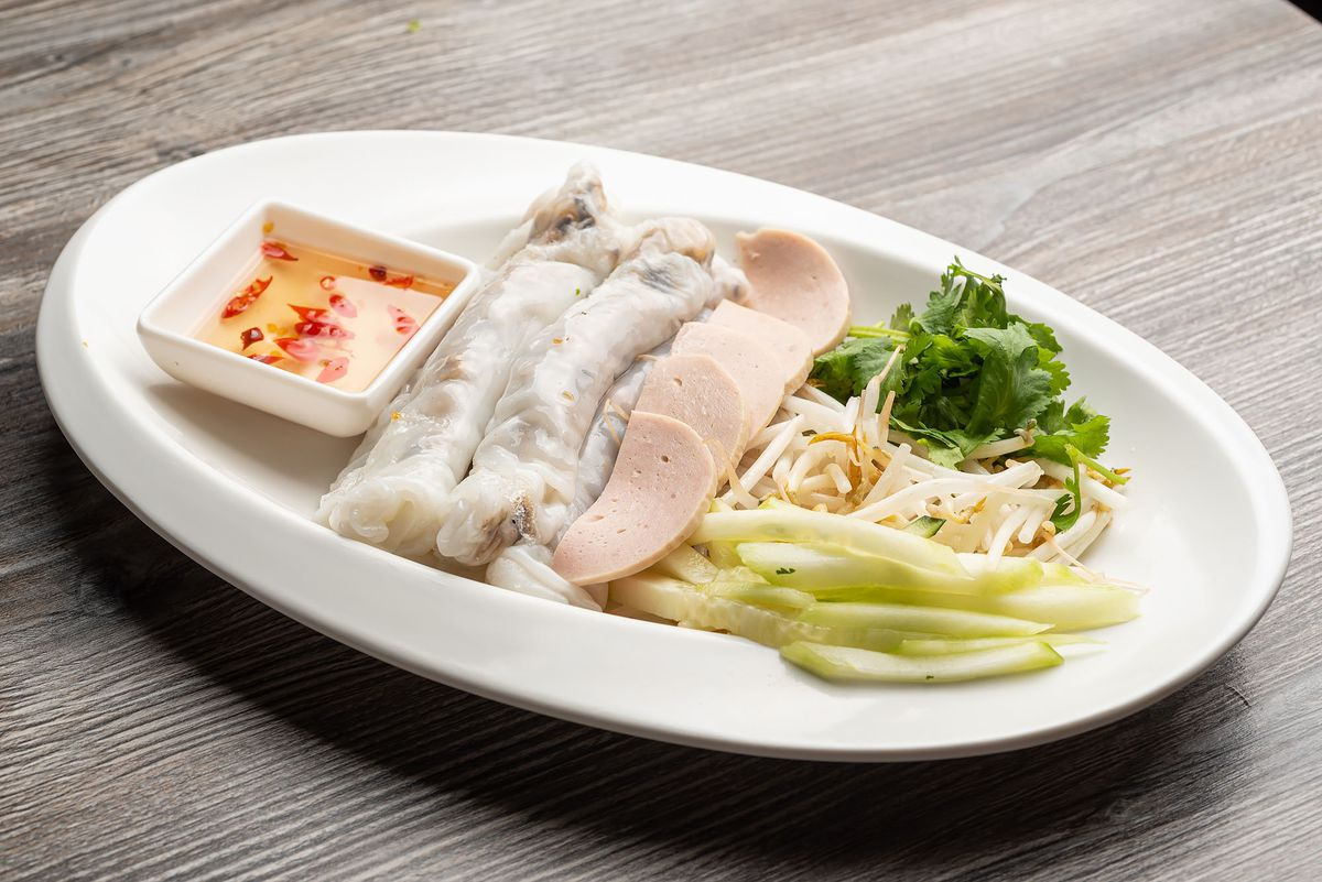 Banh cuon, steamed rice-flour crepes with ground pork and wood- ear mushrooms at Pho Ga District.