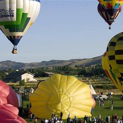 """Balloons lift off from Wolf Creek Resort in Weber County on Friday during the 15th annual Ogden Valley Balloon Festival in Eden, which runs through Sunday. Each evening at the festival field there will be a live concert with BBQ dinner offered for purchase. The popular """"Balloon Glow"""" will take place Saturday evening at dusk."""