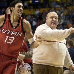 University of Utah head basketball coach Rick Majerus (right) celebrates after the Utes beat Oregon 60-58 during the first round of the NCAA tournament Friday March 21, 2003 in Nashville, Tennessee. (Submission date: 03/21/2003)