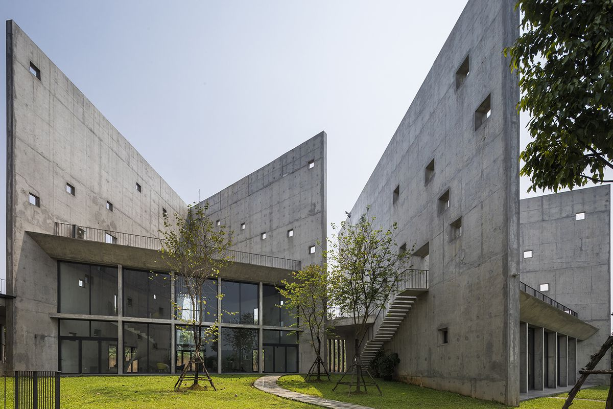 Concrete buildings on green grass