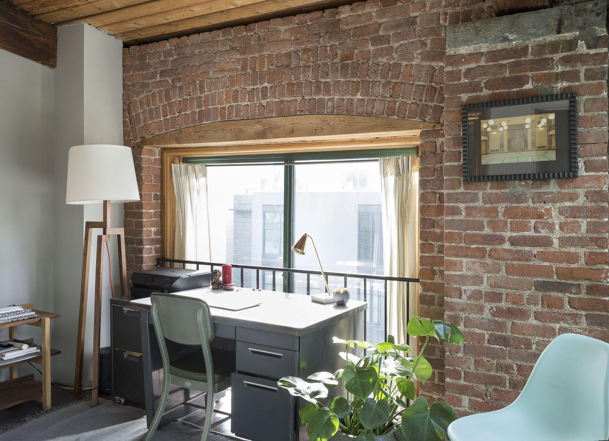 A desk sits close to a window.