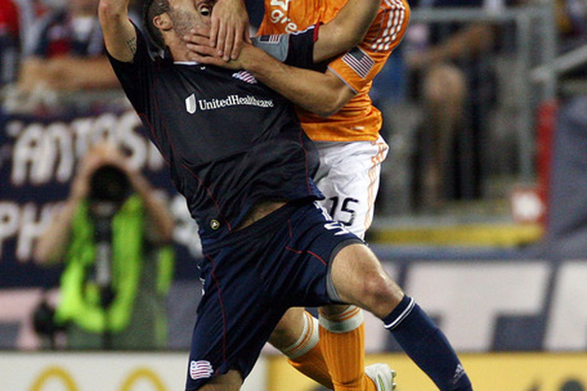FOXBORO, MA - AUGUST 17:   A.J. Soares #5 of the New England Revolution and Cam Weaver #15 of the Houston Dynamo fight for the ball at Gillette Stadium August 17, 2011 in Foxboro, Massachusetts. (Photo by Gail Oskin/Getty Images)