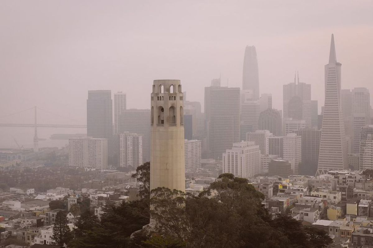 The San Francisco skyline, smothered in unhealthy gray smoke, as seen from Coit Tower.