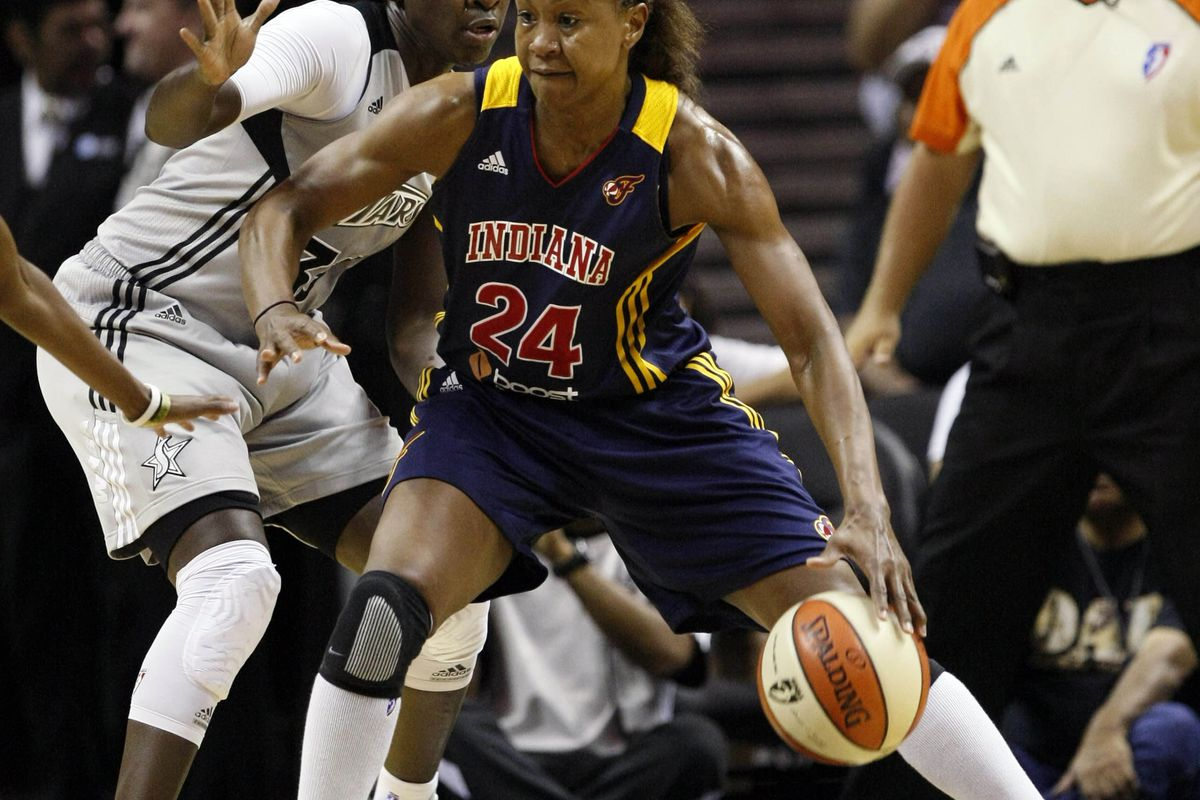 Sep 7, 2012; San Antonio, TX, USA; Indiana Fever forward Tamika Catchings (24) posts up against San Antonio Silver Stars forward Sophia Young (33) during the first half at the AT&T Center. <em>Photo by Soobum Im-US PRESSWIRE.</em>