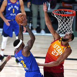 Denver Nuggets' Torrey Craig (3) shoots as Utah Jazz's Rudy Gobert (27) defends during the first half of an NBA basketball first round playoff game Sunday, Aug. 23, 2020, in Lake Buena Vista, Fla.
