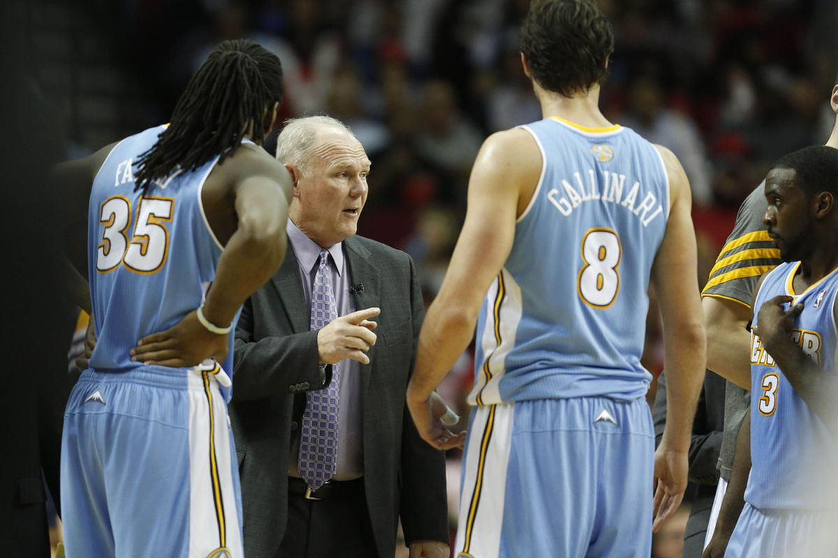 George Karl talks to small forward Danilo Gallinari (8) and forward Kenneth Faried (35) against the Houston Rockets during the second quarter at the Toyota Center. Mandatory Credit: Thomas Campbell-US PRESSWIRE