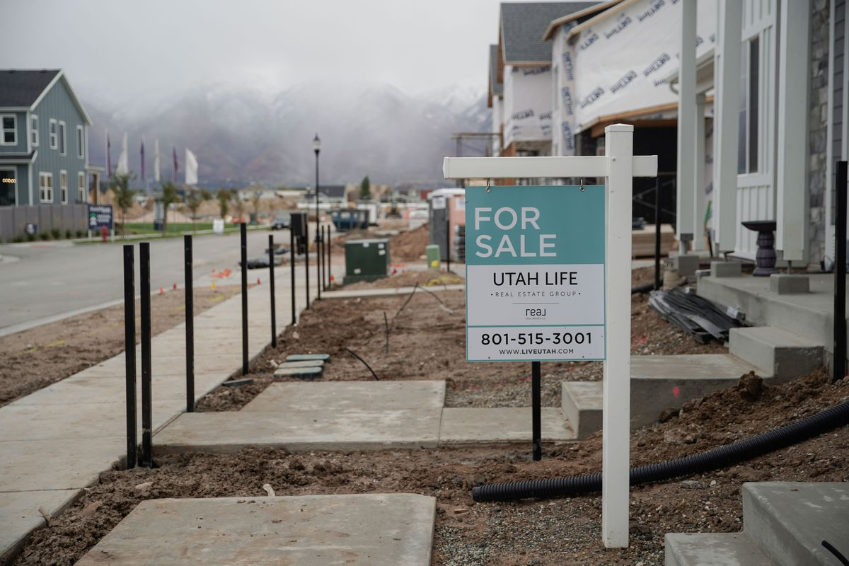 """A """"for sale"""" sign is displayed outside of a house in Layton on Thursday, Oct. 14, 2021."""