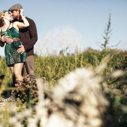 """<span class=""""credit""""><em>Couple at the Clark County Wetlands [Photo: <a href=""""http://www.orchardgrovephoto.com"""">Orchard Grove Photography</a>]</em></span>"""