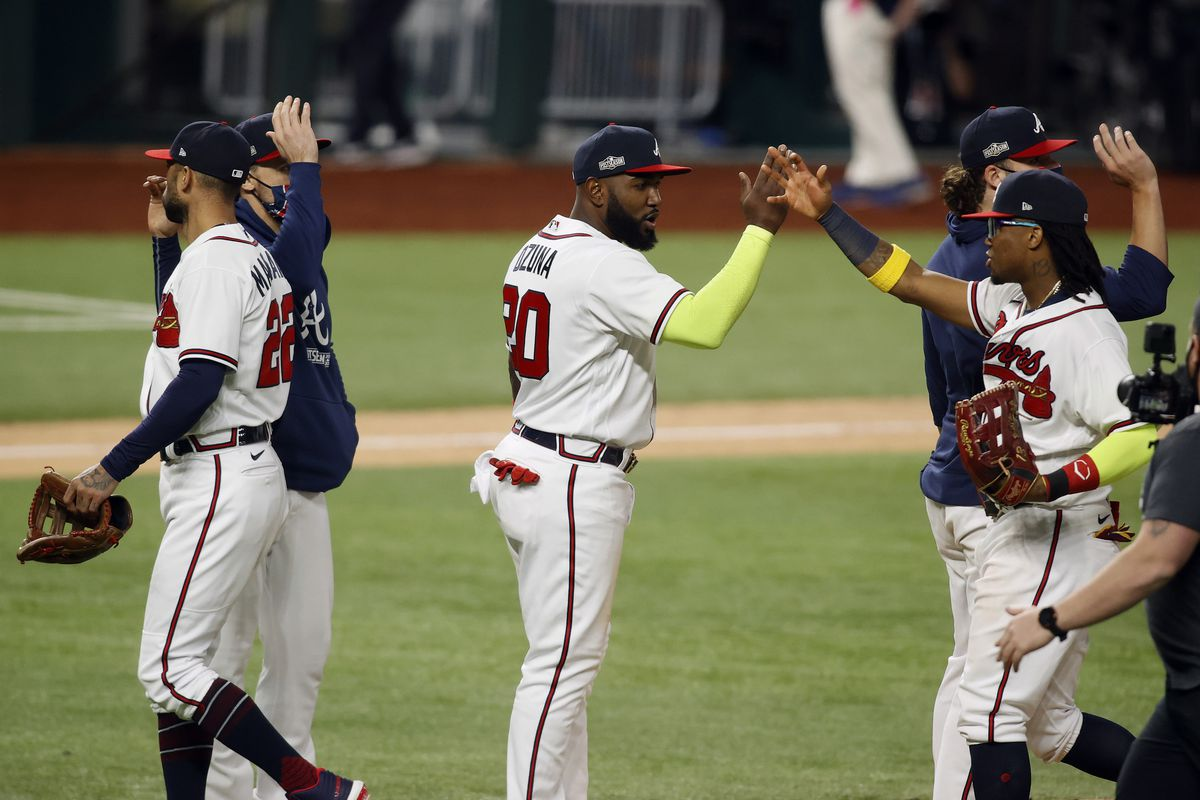 Atlanta Braves designated hitter Marcell Ozuna (20) celebrates with right fielder Ronald Acuna Jr. (right) after defeating the Los Angeles Dodgers in game four of the 2020 NLCS at Globe Life