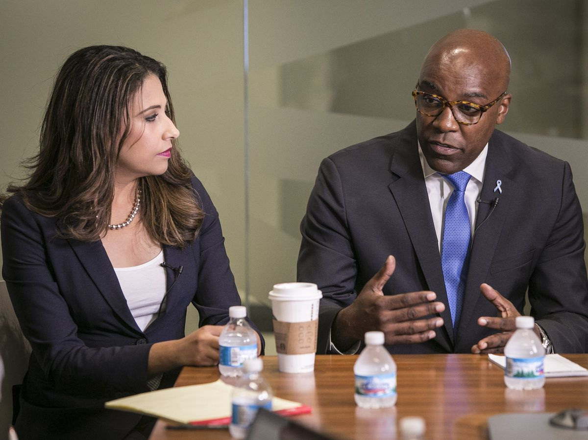 From left, Illinois Attorney General nominees Erika Harold (R) and Kwame Raoul (D) at a Sun-Times Editorial Board forum Tuesday.   Rich Hein/Sun-Times