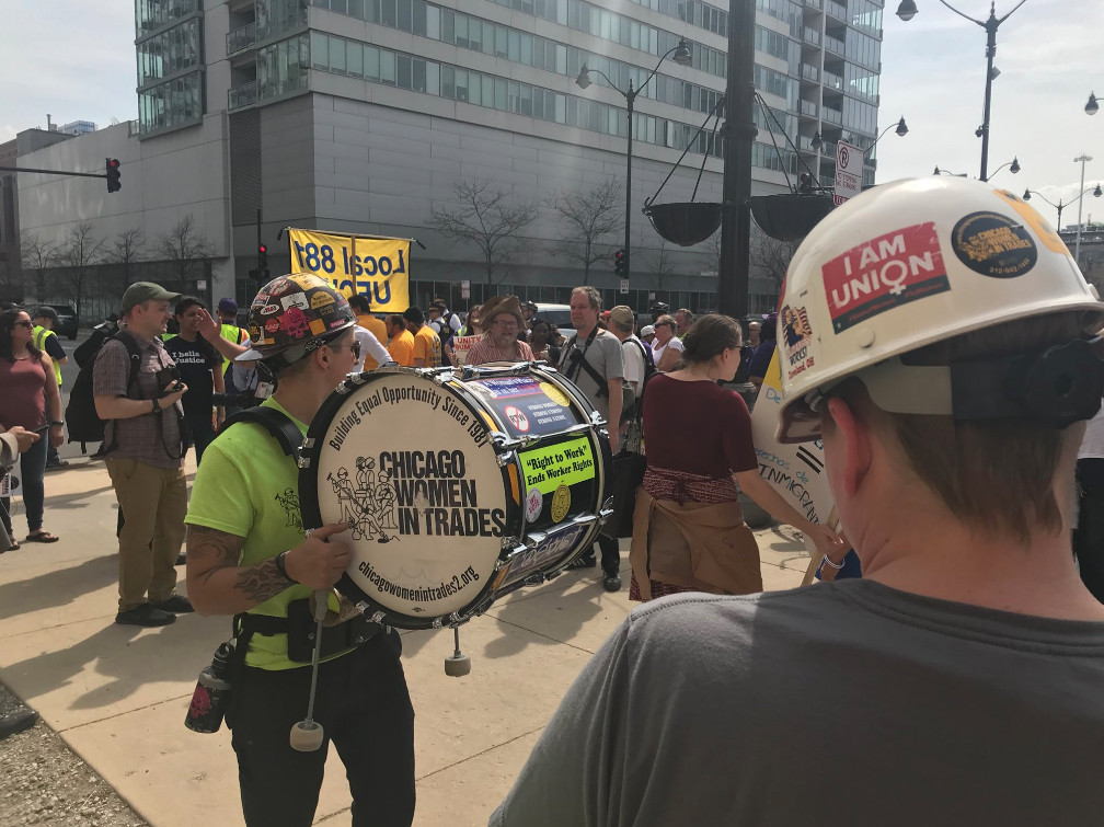 Sarah Stigler, a Local 130 plumber and member of Chicago Women in Trades carries a drum at a May Day rally Tuesday, May 1, 2018 at the Haymarket Monument on the Near West Side. | Matthew Hendrickson/Sun-Times