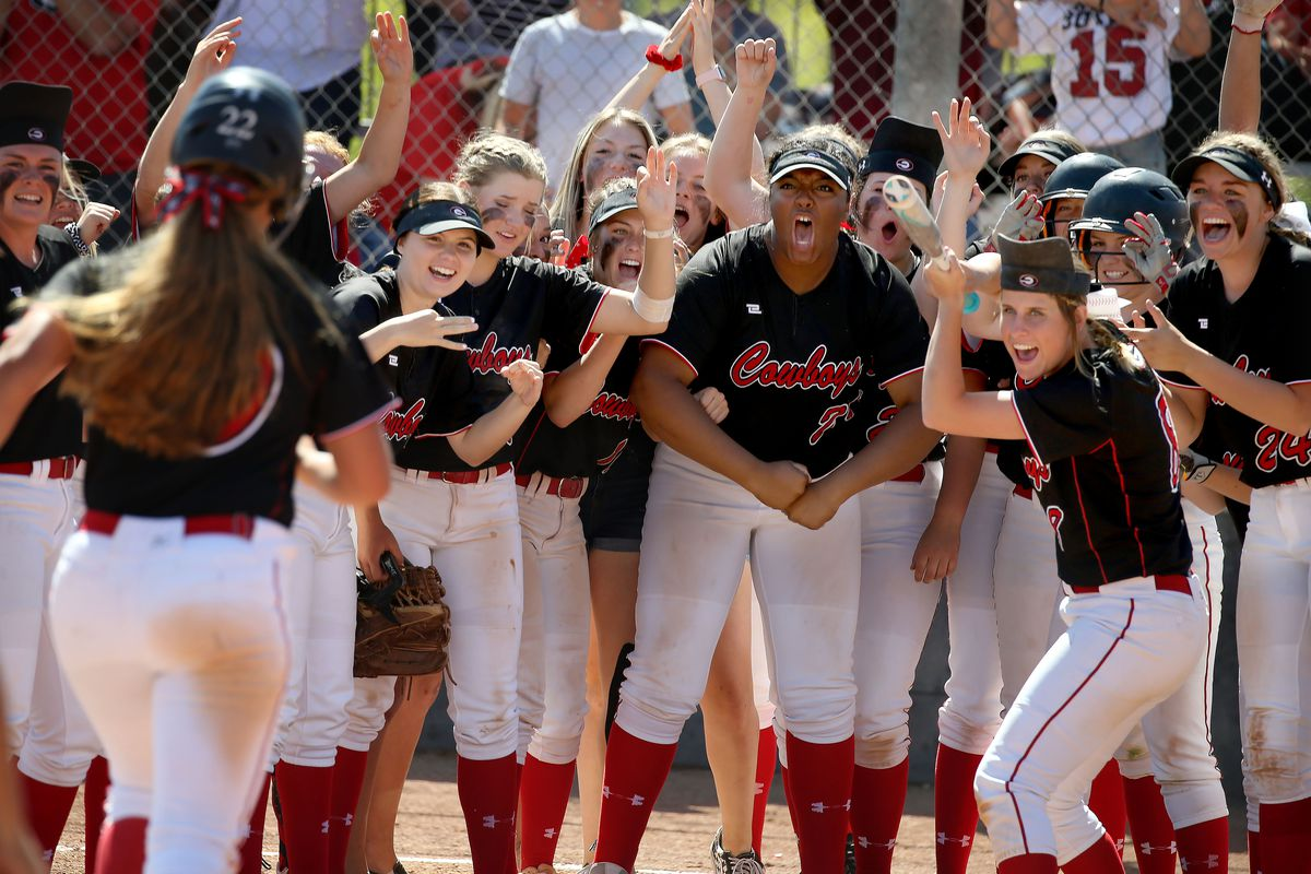 Grantsville cheers on Laura Sandberg (10) as she runs home after hitting a home run against Manti in the 3A state championship game in Spanish Fork on Saturday, May 11, 2019.