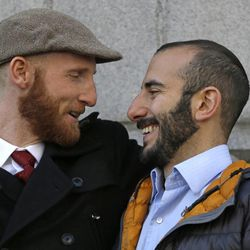 Derek Kitchen, left, and his partner Moudi Sbeity look at each other following court on Wednesday, Dec. 4, 2013, in Salt Lake City. A challenge to Utah's same-sex marriage ban by three gay couples was back in court Wednesday as a federal court judge heard arguments in a case. Kitchen and Sbeity are plaintiff's in this case.