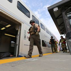 """First responders look for """"victims"""" during """"Hell on Wheels,"""" a full-scale, two-day, emergency protection and response drill at the Salt Lake Central Station on Tuesday, Aug. 8, 2017. The drill included emergency personnel from the Utah Transit Authority, the FBI, Salt Lake County Emergency Management, the West Valley and Salt Lake City fire departments, University of Utah Emergency Management, the University of Utah Police Department, Amtrak, Union Pacific, Murray Victim Advocates and Utah State Medical Examiner's Office. The drill simulated multiple terrorists entering the Salt Lake Valley and dividing up."""