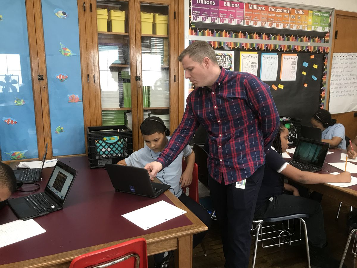 Teacher Steve Sutton works with a student on a project in a recent class at Bagley Elementary School of Journalism and Technology.