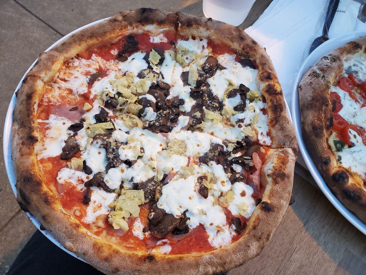 A Capricciosa pizza, with sauteed mushrooms, marinated artichokes, and prosciutto cotto, from Pupatella in Dupont Circle