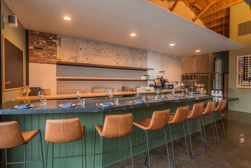 A bright, curved bar with leather seating.