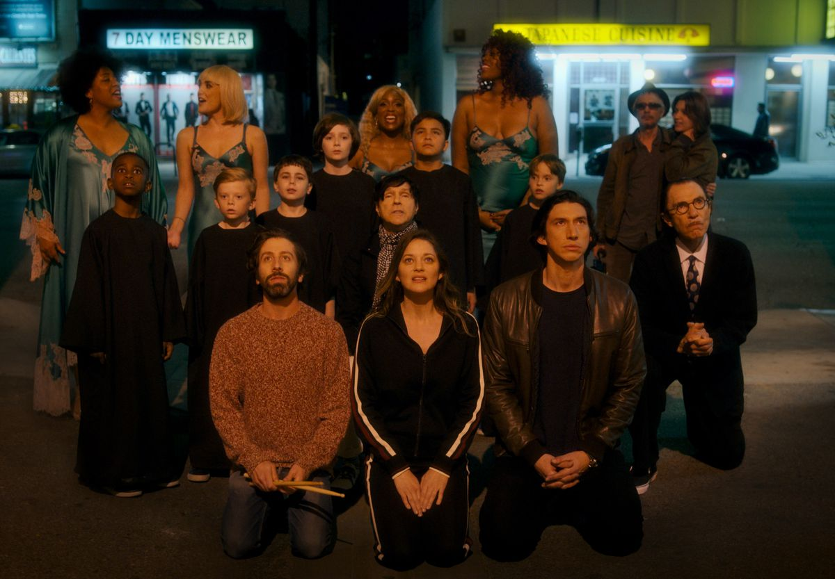 Actors, singers, composers, and directors kneel in the Los Angeles street and sing.