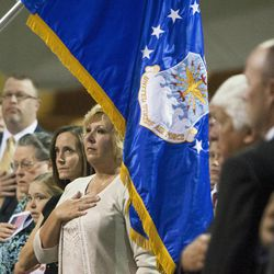 Robyle Baker, center, wife of Maj. Gen. Brent Baker Sr., watches as the colors are presented during a change of command ceremony at Hill Aerospace Museum, Monday, Sept. 8, 2014. Brig. Gen. Carl A. Buhler assumed command of the Ogden Air Logistics Complex from Maj. Gen. H. Brent Baker Sr.