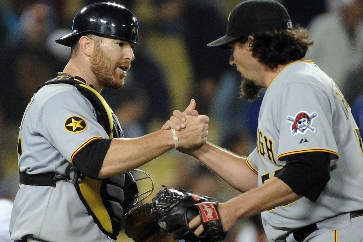 LOS ANGELES, CA - SEPTEMBER 15:  Ryan Doumit #41 of the Pittsburgh Pirates and Joel Hanrahan #52 celebrate a 6-2 win over the Los Angeles Dodgers at Dodger Stadium on September 15, 2011 in Los Angeles, California.  (Photo by Harry How/Getty Images)