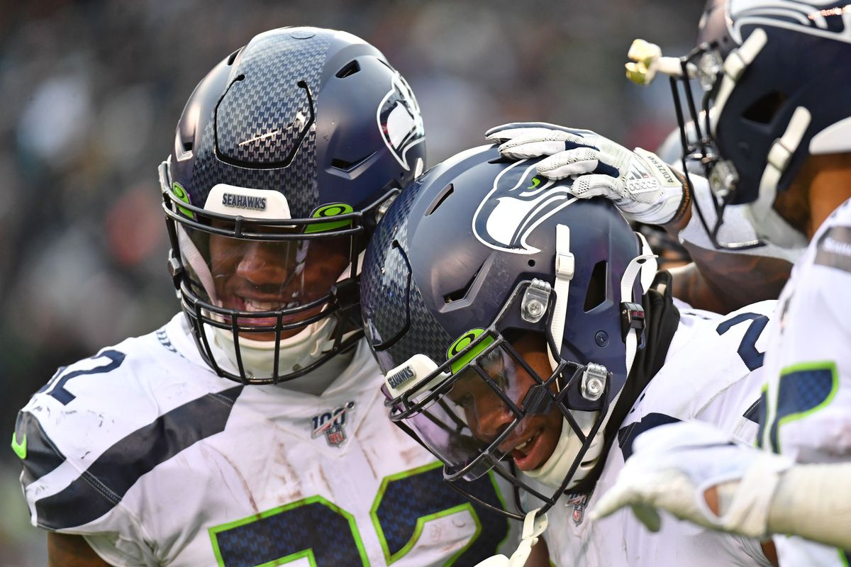 Seattle Seahawks running back Rashaad Penny celebrates his 58-yard touchdown run with running back running back Chris Carson during the third quarter against the Philadelphia Eagles at Lincoln Financial Field.