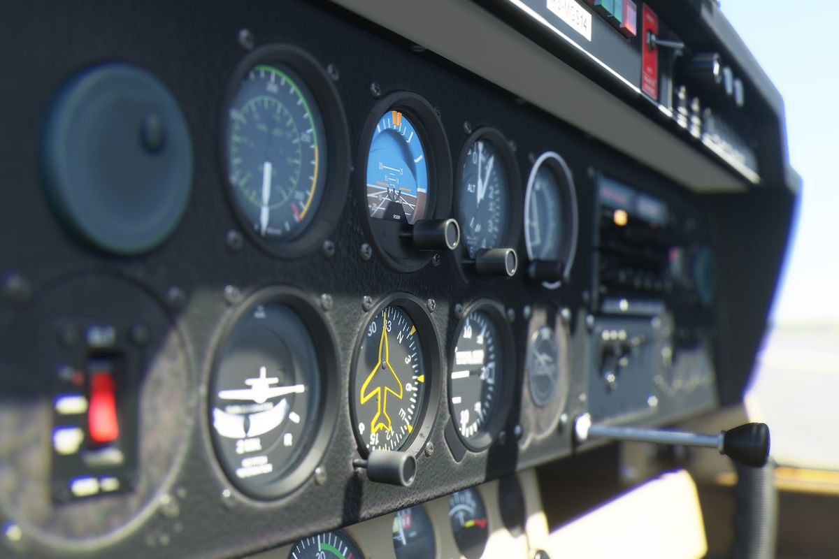 A close up of the instrumentation panel in a simulated aircraft. From an early sample of Microsoft Flight Simulator. The image shows extreme depth of field effects and high-resolution textures.