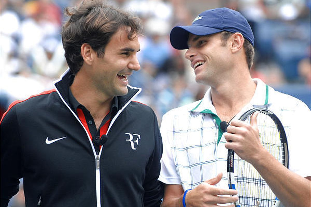 Roger Federer, left, and Andy Roddick share laughs during the Arthur Ashe Kids Day before the U.S. Open begins.
