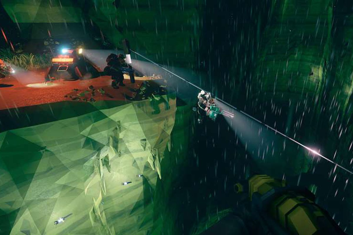 Players hook onto a zipline before crossing a massive crack in the ground.