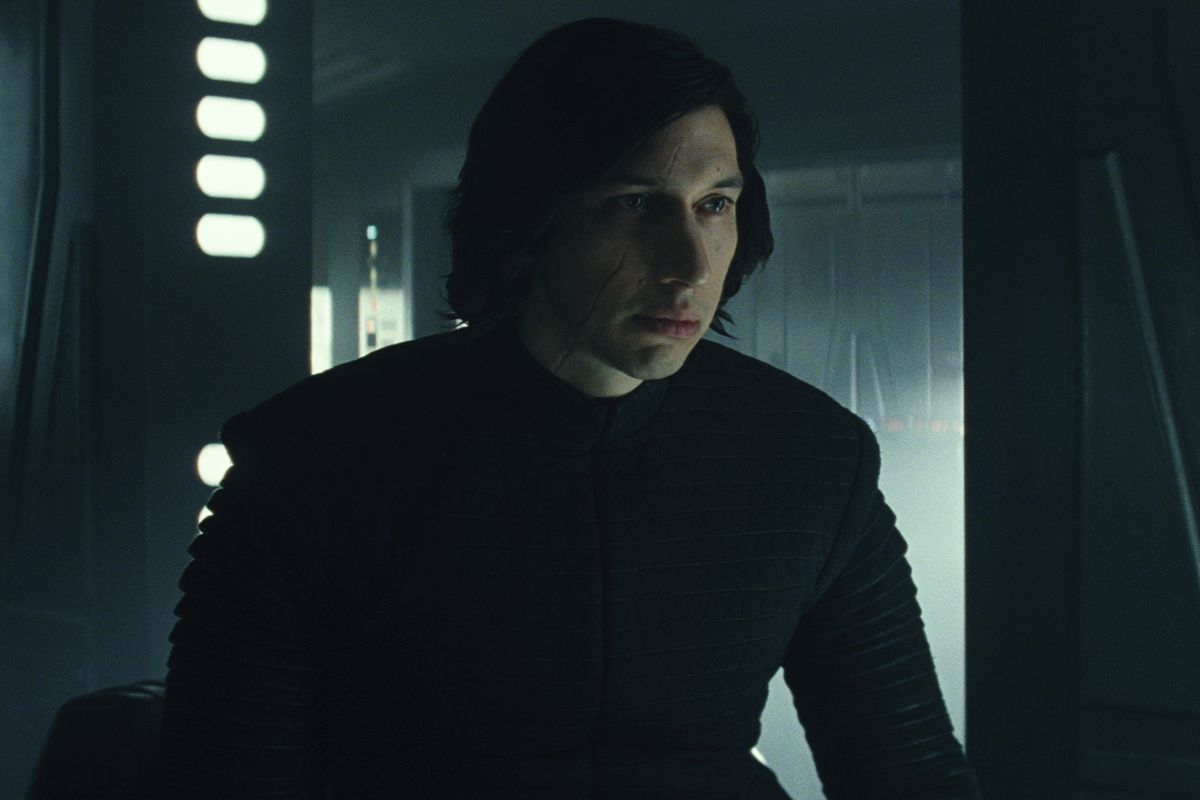Kylo Ren (Adam Driver) inside a futuristic room, staring at something off screen in Star Wars: The Last Jedi