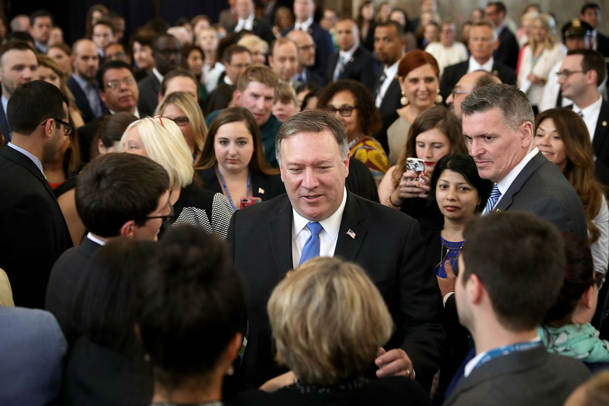 Secretary of State Mike Pompeo greets employees during a welcome ceremony on May 1, 2018.