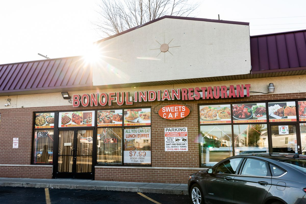 The exterior of Bonoful in a strip mall on a sunny evening with a car parked out front.