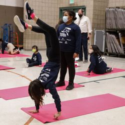 Mountain View Elementary students performs yoga as a part of their team running practice on Thursday, Sept. 16, 2021, at the school in Salt Lake City. The Larry H. & Gail Miller Family Foundation donated 1,000 pairs of Asics running shoes to underserved girls participating in the Girls on the Run Utah character development program.