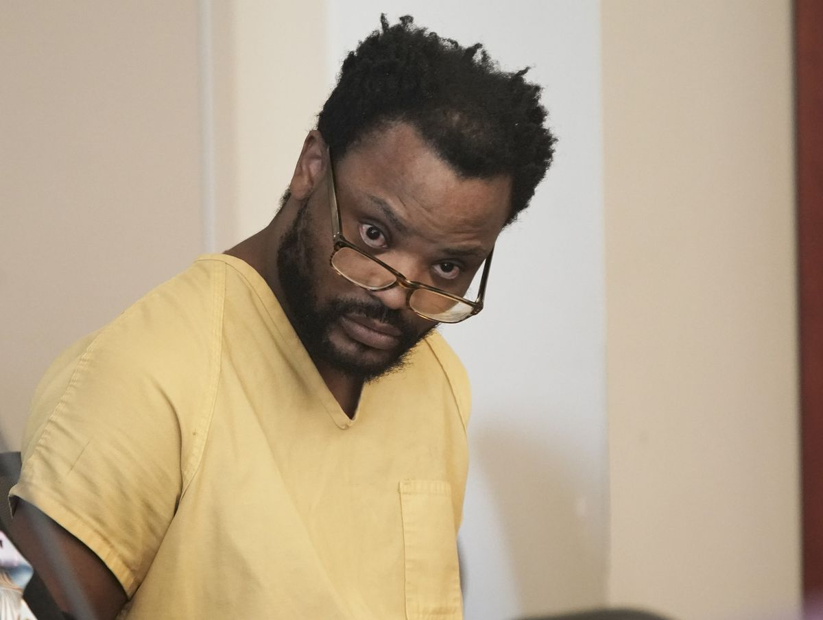 Ayoola Adisa Ajayi, accused of murdering University of Utah student Mackenzie Lueck and setting fire to her body, appears in court in Salt Lake City on Friday, Dec. 20, 2019.